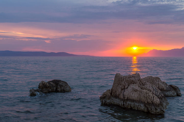 Sunset in Makarska, Croatia Beauty In Nature Horizon Over Water Nature No People Outdoors Rock - Object Scenics Sea Sky Sun Sunlight Sunset Tranquil Scene Tranquility Water Waterfront