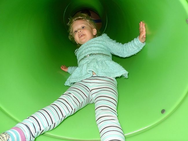 One Person Childhood Green Color Full Length Happiness Indoors  Child Toddler  Little Girl Having Fun Smiling Sliding Down Slide Tunnel View EyeEm EyeEm Gallery Finding New Frontiers Eyeem Market Eyeem Photography Eyeem Photo Architectural Design Pennsylvania Uniqueness Resist The Portraitist - 2017 EyeEm Awards Live For The Story Let's Go. Together.