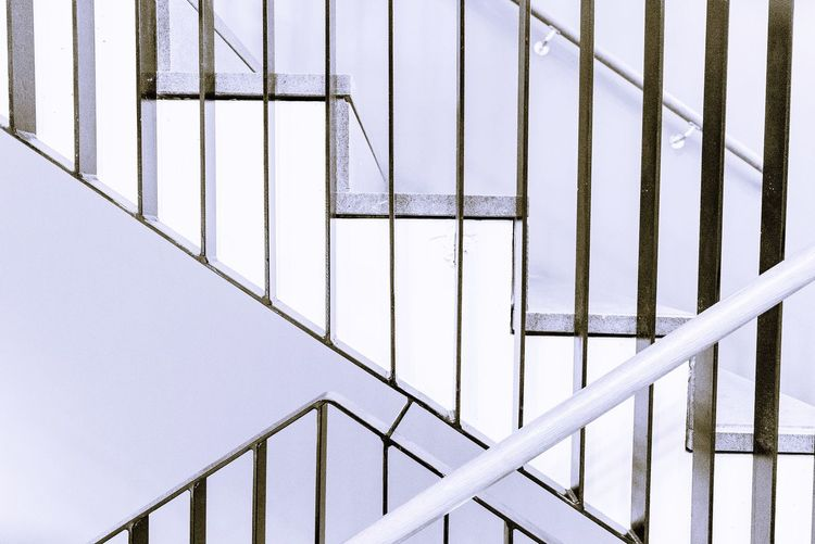 Lines forming a pattern Building Interior Diagonal Lines Staircase Stair House EyeEm Selects Railing Metal Steps And Staircases Architecture Staircase Built Structure No People Indoors
