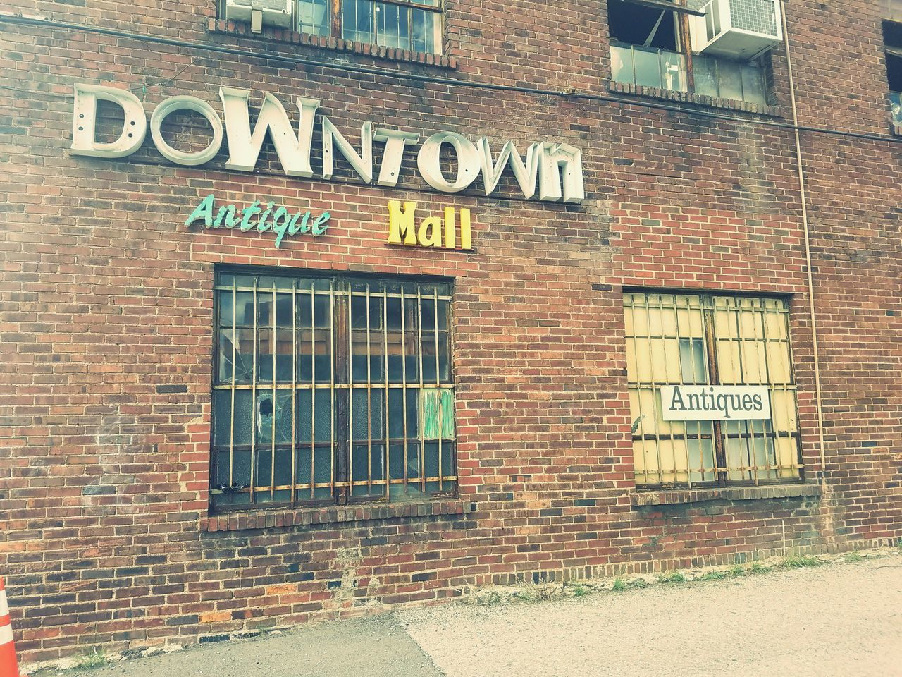 text, western script, building exterior, architecture, built structure, communication, capital letter, brick wall, store, window, outdoors, day, no people, open sign