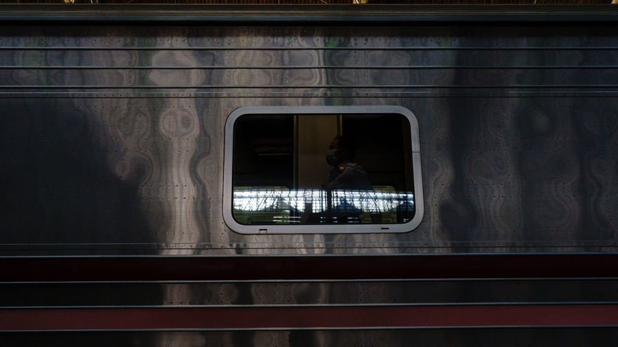 Reflection of train on window at railroad station
