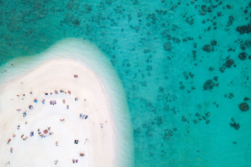 Aerial view or top view of beautiful curve beach with traveller relaxing with the emerald sea at Koh Lipe island in Satun, Thailand. Koh Lipe Above Above View Aerial View Aerial Andaman Sea ASIA Backgrounds Beach Beautiful Nature Blue Clear Water Coast Copy Space Coral Crowd Curve Drone  Droneshot Holiday Island Krabi Thailand Landscape Mediterranean  Natural Nature Ocean Outdoors People Phuket Reef Relaxation Sand Sandy Beach Sea Seascape Shore Summer Swimming Thailand Top View Tourism Tourist Travel Travel Destinations Traveler Tropical Turquoise Water Vacations View View From Above Water Wave Waves, Ocean, Nature White Color