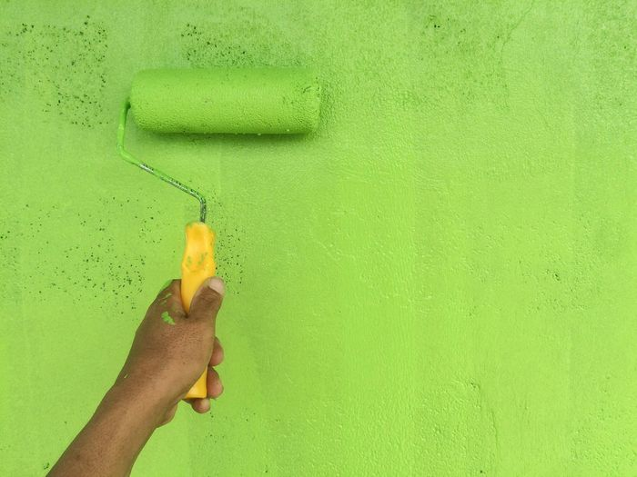 Hand painting wall using wall brush. green wall painting EyeEmNewHere EyeEm Best Edits EyeEm Selects EyeEm Best Shots Human Hand Human Body Part Green Color Holding One Person Real People Paint Roller Close-up People Water Day Outdoors