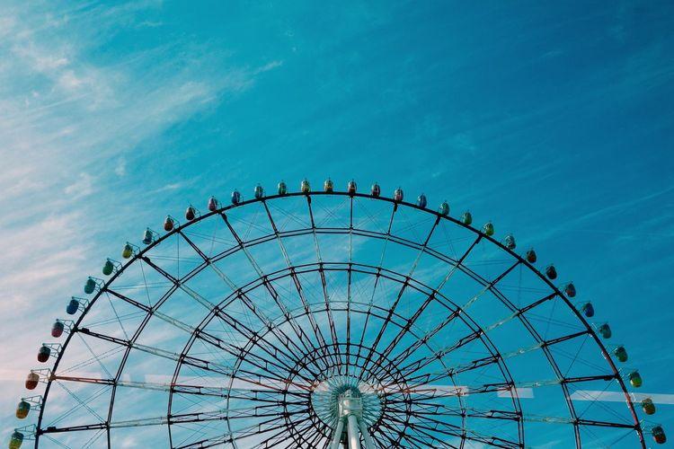 Amusement Park Amusement Park Ride Architecture Arts Culture And Entertainment Blue Built Structure Carnival Cloud - Sky Day Ferris Wheel Geometric Shape Large Low Angle View Nature No People Outdoors Semi-circle Shape Sky Traveling Carnival