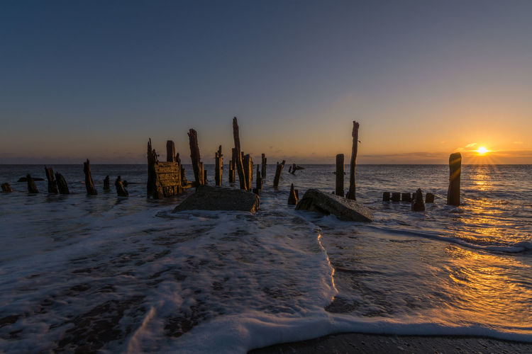 Spurn Point old wooden groynes and beach sea defences Hull Kilnsea Light Spurn Point Yorkshire Beach Beauty In Nature Coast Costal Golden Hour Groynes Horizon Over Water No People Sand Scenics Sea Sea Defences Sky Spurn Point Sun Sunrise Tide Tranquil Scene Tranquility Wave Wooden Post