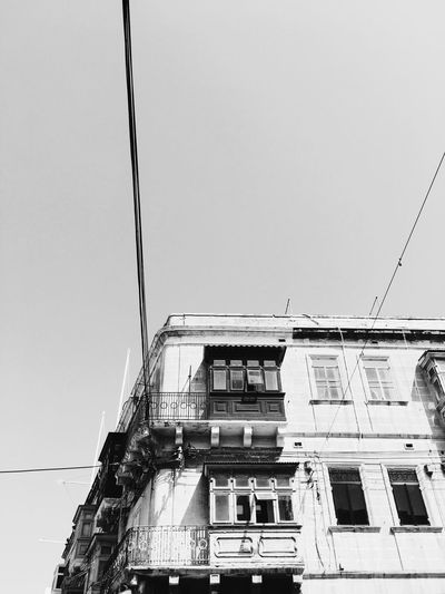 Malta's balconies Architecture Building Exterior Built Structure Low Angle View Window Clear Sky Building Residential Structure Cable City Sky Day Power Line  Outdoors No People High Section Vscocam VSCO Vscogood IPhoneography