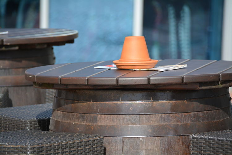 Wooden table and chairs at sidewalk cafe