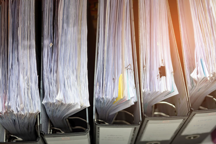 Full frame shot of documents in ring binders at office
