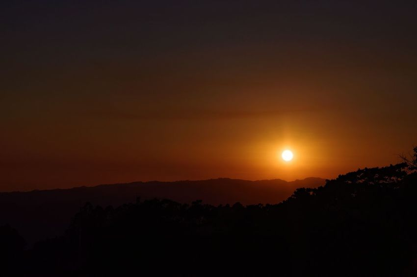 As the sun falls Sunset Sun Moon Scenics Beauty In Nature Silhouette Nature Tranquil Scene Landscape No People Sky Astronomy Tranquility Outdoors Beauty Tree Area Space Mountain Tree