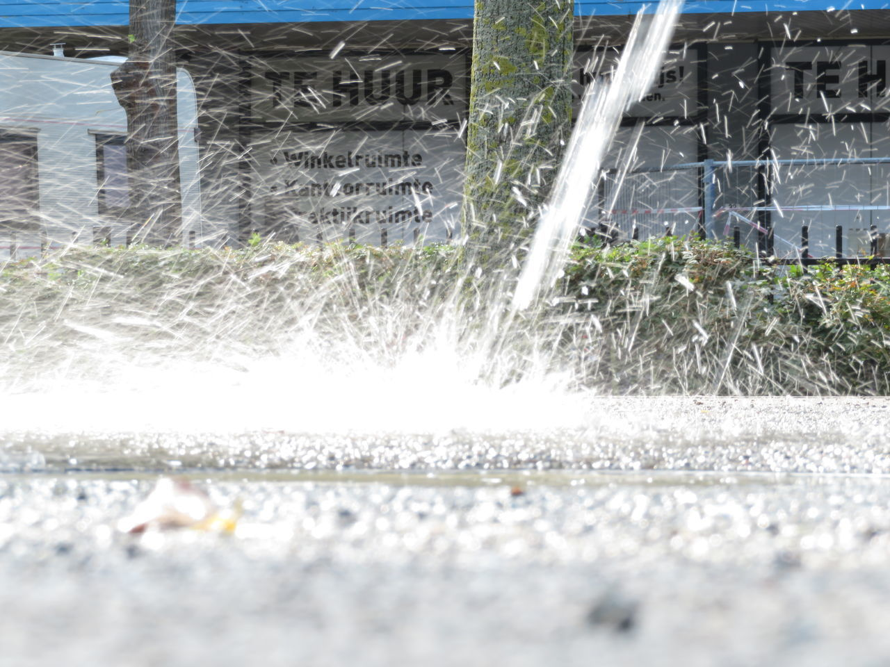 motion, architecture, day, nature, water, outdoors, sunlight, blurred motion, no people, speed, plant, splashing, transportation, city, built structure, street, building exterior, surface level, road, gardening, flowing water