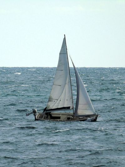 Transportation Nautical Vessel Mode Of Transport Clear Sky Boat Water Sailboat Horizon Over Water Canvas Sailing Beauty In Nature Nature Tranquil Scene Water Lappping The Bow