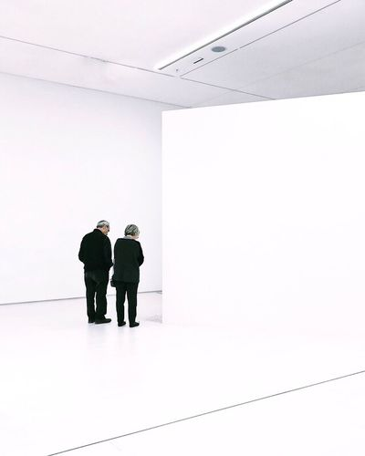 Two People Men Indoors  Full Length Mature Adult Real People Standing Businessman Well-dressed Occupation Architecture Togetherness Women Business Teamwork Working Technology Day Adult Adults Only Minimal Getty X EyeEm Gettyimagesgallery Gettyimages