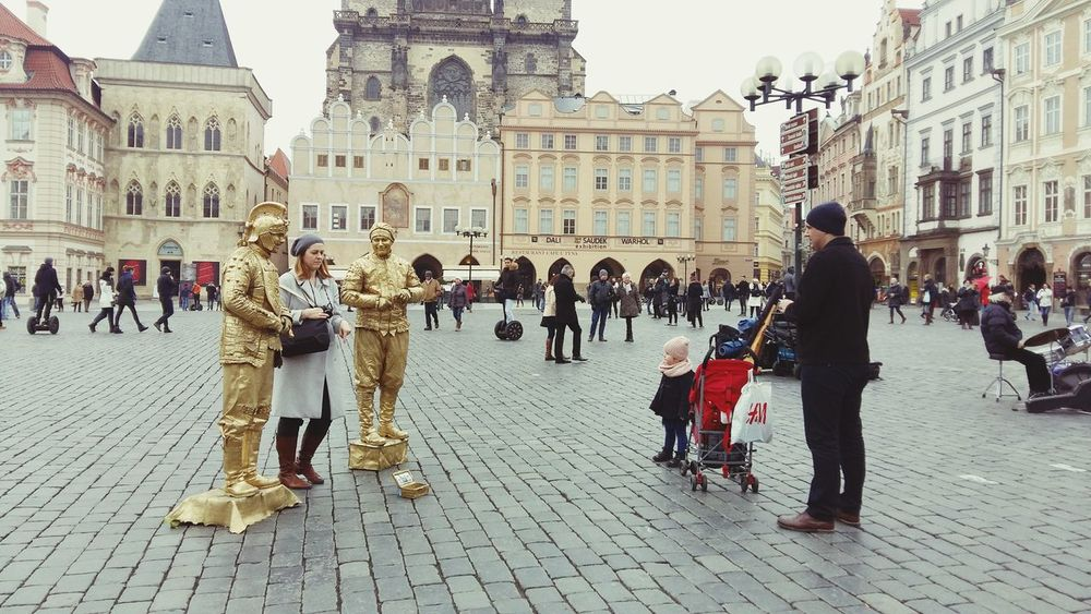 Prague Main Square Babygirl Shy Artist Old Town look at her lovely!! She is too shy to get closer with two golden costumed man.