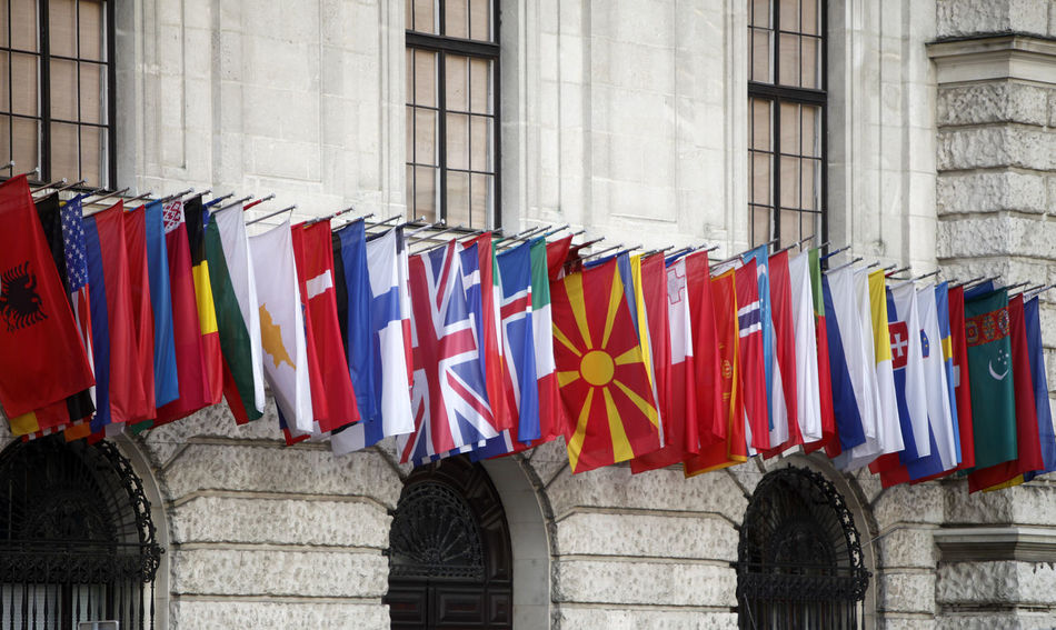 International flags at the Hofburg in Vienna Architecture Austria Collection Country Flag Hanging Headquarter Hofburg In A Row International Multi Colored Symbol Vienna