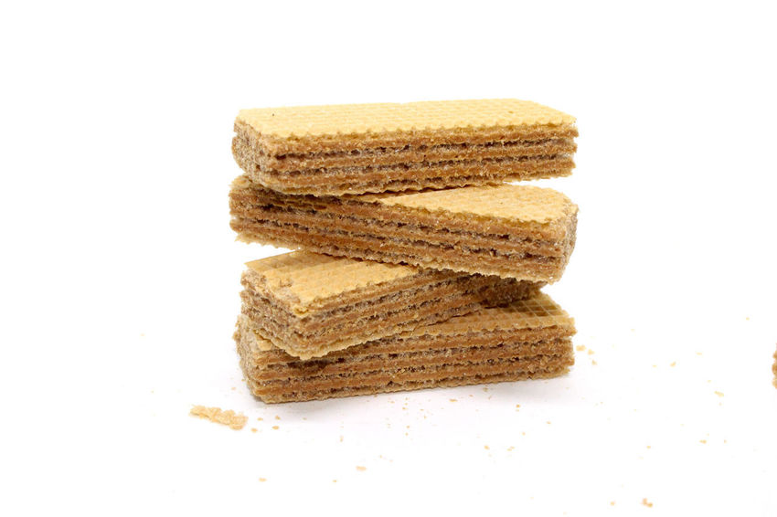 Wafer Brown Candy Close-up Cookies-biscuits Cream Cut Out Food Food And Drink Freshness Indoors  No People SLICE Snacks-sweets Still Life Studio Shot Sweet Food Wafer Wafer Rolls White Background
