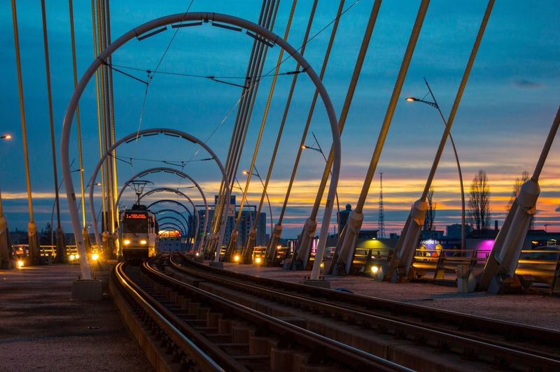 Cable Car Against Sky During Sunset At Railway Bridge In City