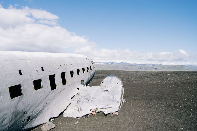 VIEW OF PLANE WRECKAGE IN MOUNTANS