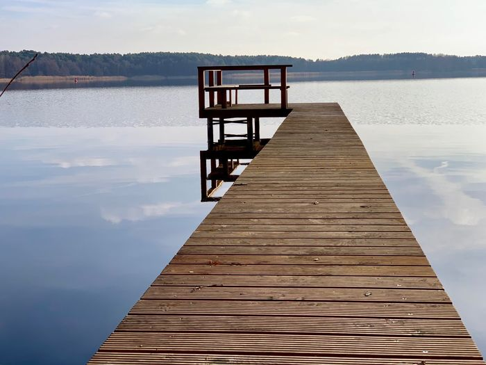 Water Sky Lake Beauty In Nature Pier Nature Wood - Material Tranquility Cloud - Sky Tranquil Scene Day Scenics - Nature Reflection Architecture Built Structure No People Jetty Non-urban Scene Outdoors
