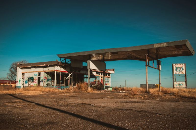 Abandoned Gas Station Clear Sky Blue Built Structure Fuel Pump No People Architecture Sky Outdoors Day Building Exterior