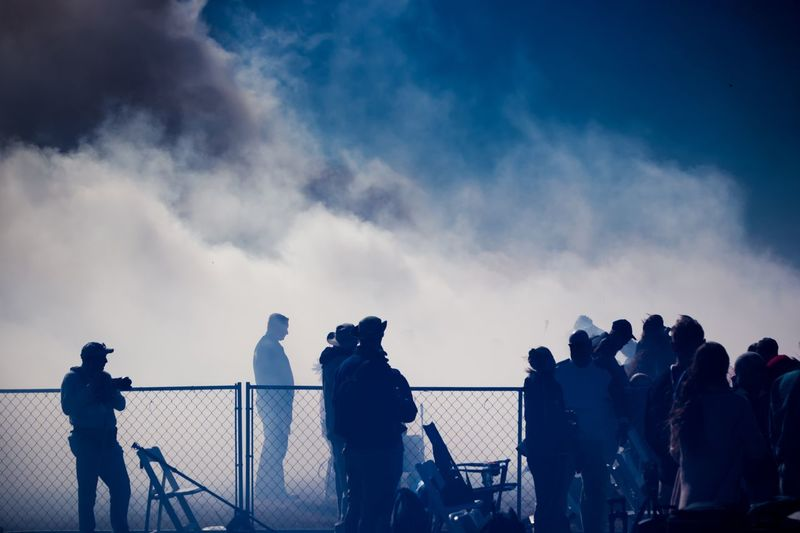A lot of smoke The Week On EyeEm Smog Dangerous Sky Men Real People Railing Women Silhouette Cloud - Sky Leisure Activity Photographing Large Group Of People Sunset Togetherness Outdoors