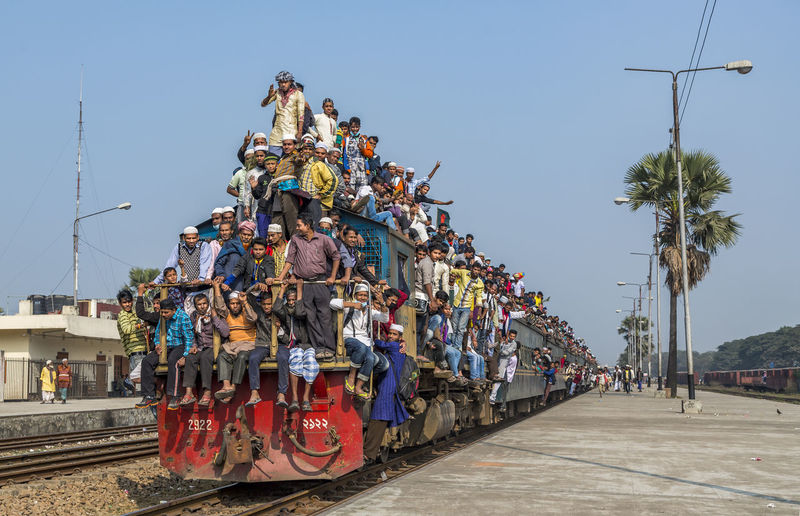 2922 Bangladesh Clear Sky Crowd Day Large Group Of People Lifestyles Men Mode Of Transport Outdoors Packed People Peoples On Loco Peoples On Tr Real People Sky Train Transportation