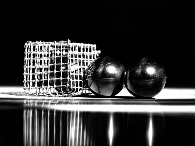 LIFE IN SIN Alloy Ball Black Background Close-up Copy Space Food Food And Drink In A Row Indoors  Kitchen Utensil Metal No People Reflection Shiny Side By Side Silver Colored Sphere Steel Still Life Studio Shot Table Two Objects