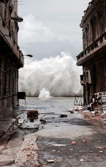Explosive sea waves against buildings