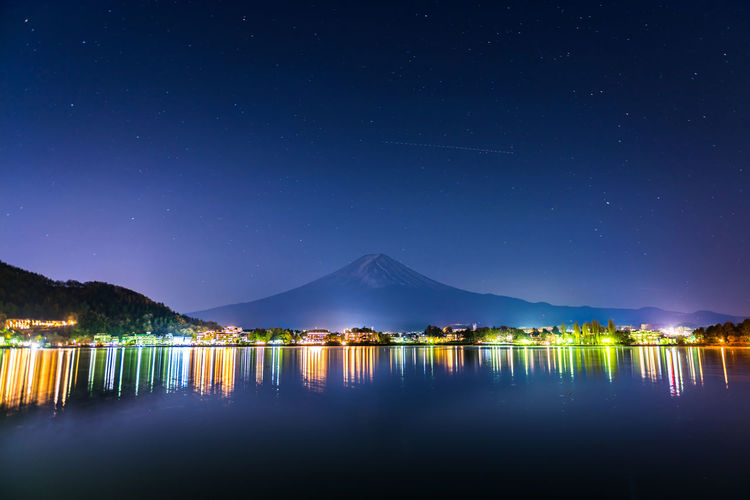 Fuji Mountain in night time at Kawaguchiko lake, Japan Fuji Mountain Fujisan Japan Kawaguchiko Night Lights Nightphotography Scenic Yamanashi Astronomy Beauty In Nature Fuji Galaxy Lake Landscape Mountain Mountains Nature Night Reflection Sky Space Star - Space Water Waterfront