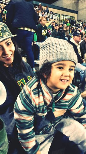 Lei and Cash watching Uncle Levi score a touchdown