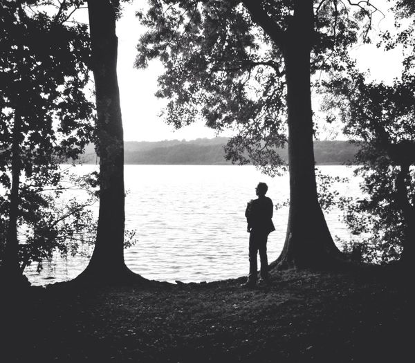 Father and Baby looking out over a Lake