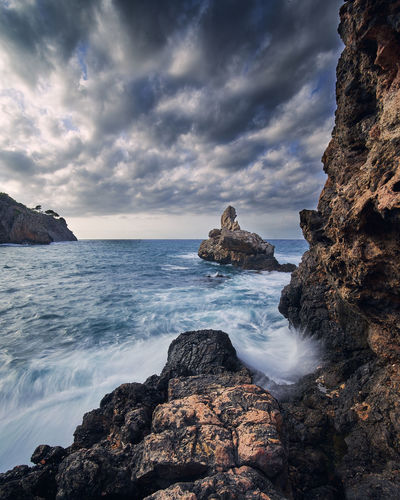 darkness rocks EyeEm Best Shots Dramatic Sky Beach Beauty In Nature Cloud - Sky Eroded Horizon Horizon Over Water Land Motion Nature No People Outdoors Power In Nature Rock Rock - Object Rock Formation Rocky Coastline Scenics - Nature Sea Sky Splash Tranquility Water Wave