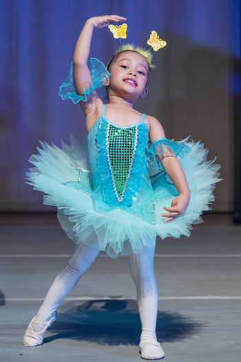 Full Length Of Girl Dancing On Stage