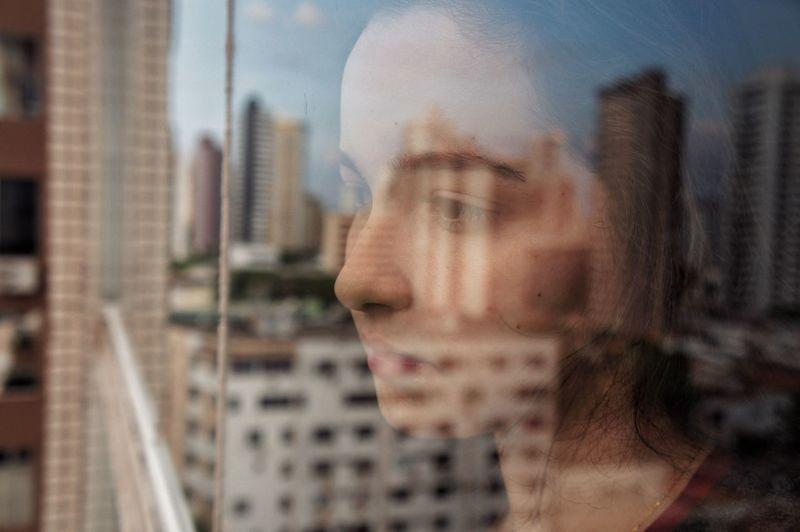 Beautiful girl looking at city buildings