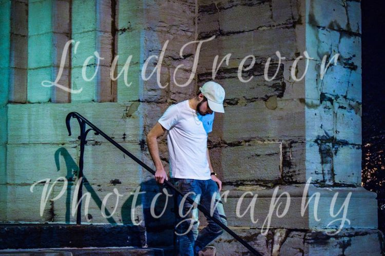 Late night shot in downtown Plattsburgh Graffiti Spray Paint Text Street Art One Person Casual Clothing One Man Only Communication Adult Youth Culture Young Men Outdoors Young Adult Full Length Standing People Only Men Adults Only Day Aerosol Can plattsburgh