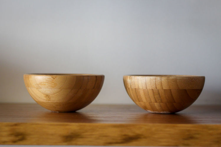 Two wooden bowls b.s Bowl Brown Close-up Copy Space Day Food Food And Drink Freshness Gray Background Group Of Objects Healthy Eating Indoors  No People Selective Focus Side By Side Simplicity Still Life Table Two Objects Wood - Material