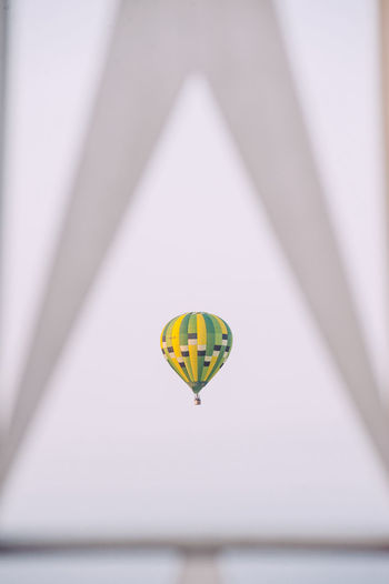 Distant view of hot air balloon flying in sky