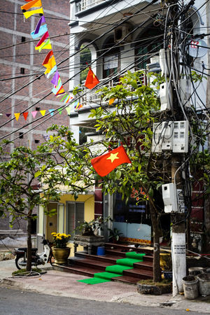 traveling Vietnam 2018 ASIA Travel Traveling Vietnam Architecture Building Building Exterior Built Structure City Day Decoration Explore Flag Growth Hanging House Lighting Equipment Multi Colored Nature No People Outdoors Plant Potted Plant Residential District Tree