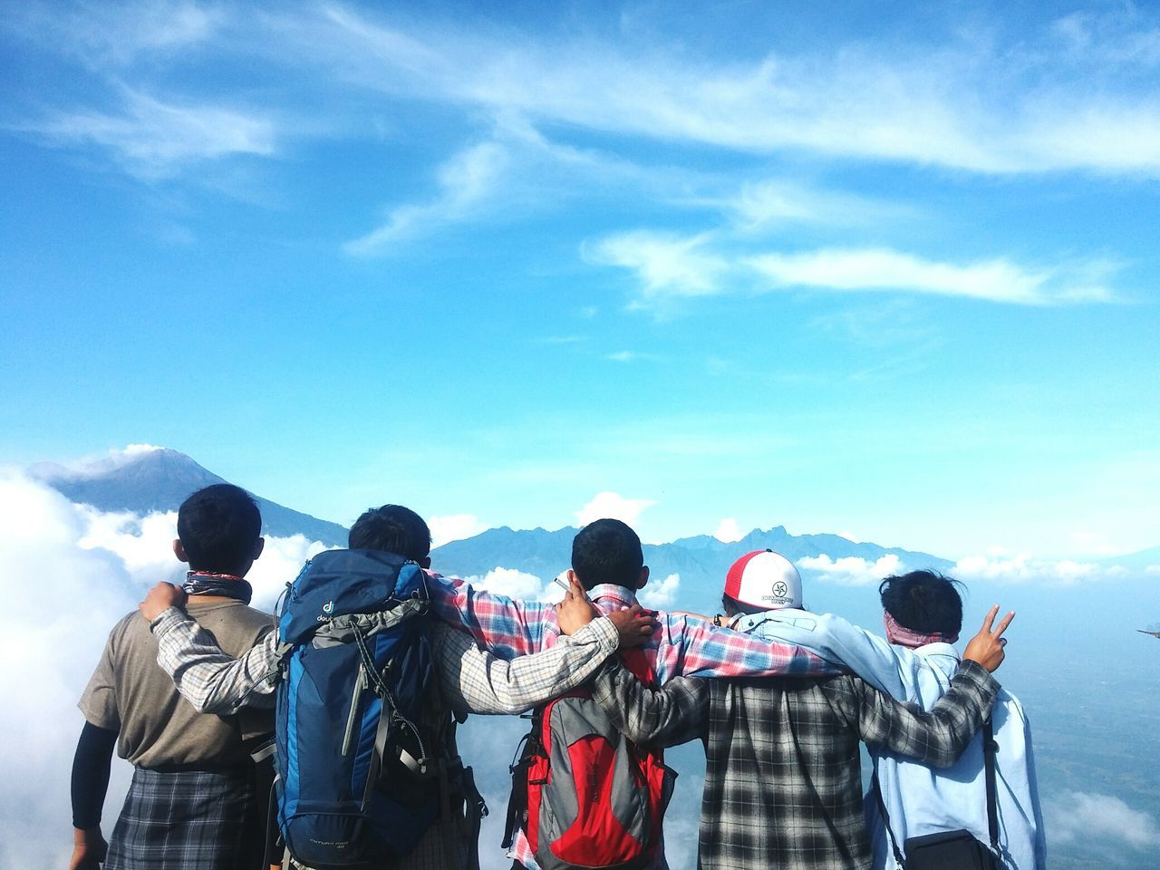 sky, day, rear view, real people, medium group of people, men, mountain, nature, blue, cloud - sky, sunlight, beauty in nature, outdoors, togetherness, people