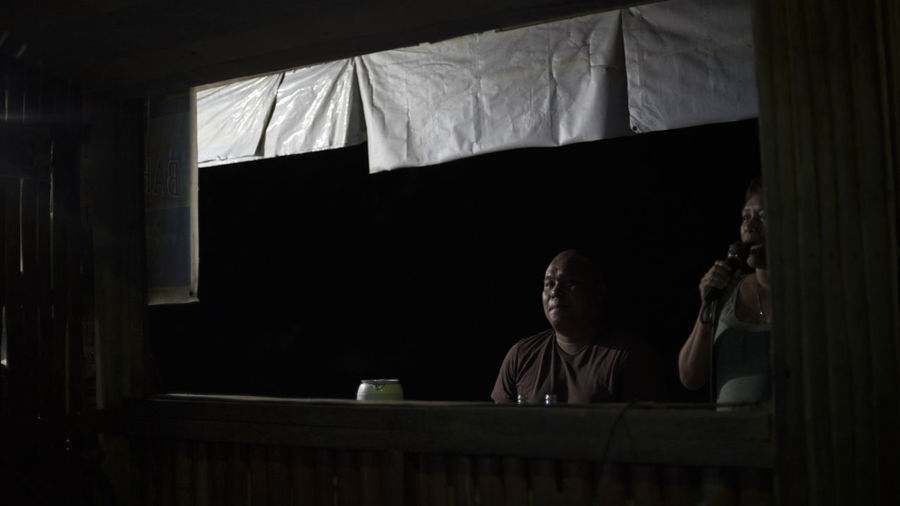 Man sitting by window at night