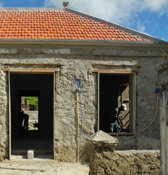 Punda Curacao Punda Curacao Builders Construction Work House Built Structure Architecture Outdoors Day (c) 2016 Shangita Bose All Rights Reserved Curacao (willemstad) Curacao People Workers Workers At Work Willemstad Snbcuracao