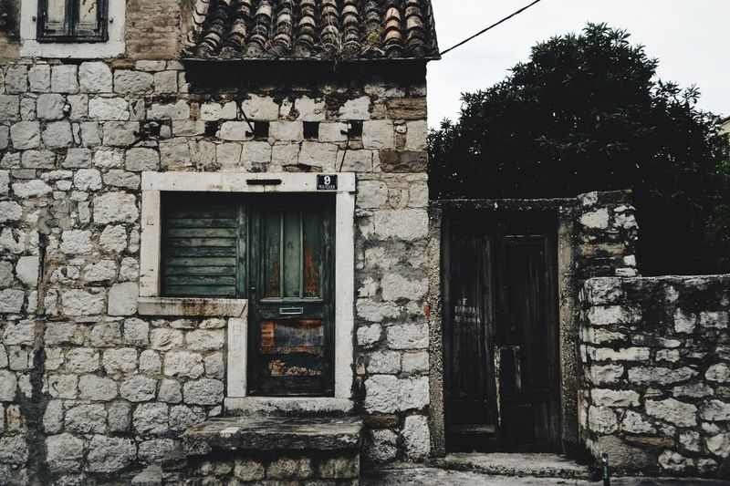 Architecture Built Structure Building Exterior House Door Window Closed Old Brick Wall Weathered History The Past Entrance Façade Bad Condition Outdoors Day Stone Material Damaged Obsolete Croatia Split Split Croatia Hvar