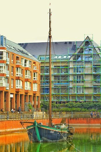 Boat in the city Architecture Built Structure Building Exterior Sky Building City Day Clear Sky Outdoors Sunlight Water Sunny Rheinpromenade Düsseldorf Rhein Sailing Waterfront Düsseldorf Water Boat Museum Outdoor Photography History Visiting Nature