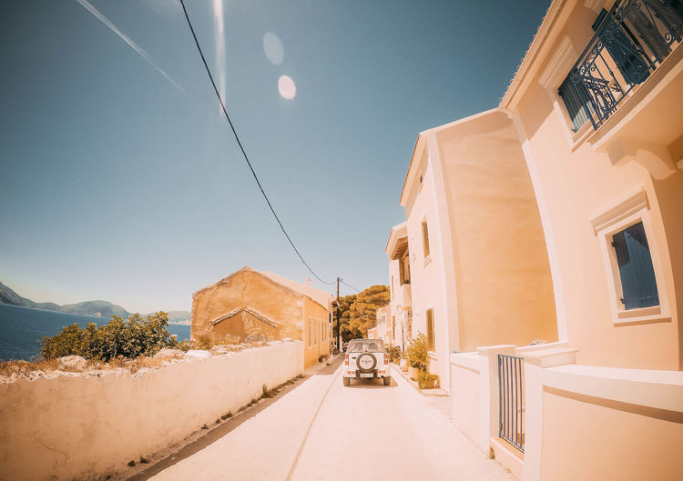 Architecture Building Exterior Sky Built Structure Building Nature No People Tree Day Plant Clear Sky Sunlight Outdoors The Way Forward Direction Mountain Road Blue Residential District Scenics - Nature Perspective Greece Kefalonia Driving Streetphotography