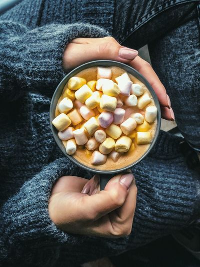 Midsection Of Woman Having Drink With Marshmallows