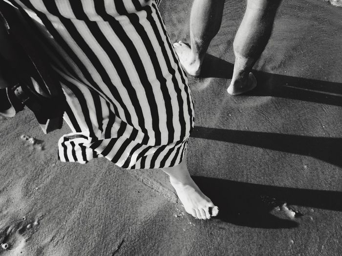 barefoot Beach Low Section Human Body Part Striped Real People Shadow Human Leg Body Part Sunlight Day Outdoors Women