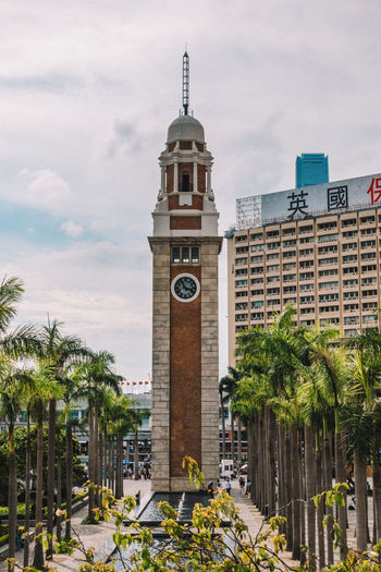 Clock tower against cloudy sky