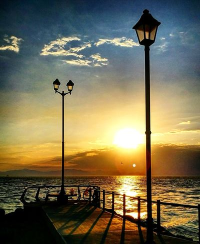 Sunset Sea Sky Lighting Equipment Sunlight Water Nature Sun Summer Outdoors Beauty In Nature Day Vacations