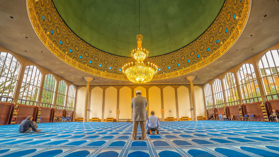 Praying in mosque Adult Architectural Column Architecture Belief Building Built Structure Ceiling Full Length Illuminated Indoors  Islam Islamic Islamic Architecture Lighting Equipment Men Pattern Place Of Worship Praying Real People Rear View Religion Spirituality Standing Tiled Floor Travel Destinations