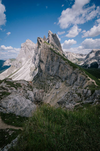 Seceda Beauty In Nature Nature Outdoors Dolomites, Italy Seceda Moutains Sky Mountain Environment Rock Grass Landscape Cloud - Sky Scenics - Nature Plant Tranquil Scene Day Non-urban Scene Tranquility No People Idyllic Rock - Object Mountain Range Mountain Peak Formation