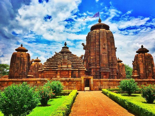 The Beautiful & Majestic Brahmeswar Temple, Bhubaneswar, India Architecture Built Structure Sky Place Of Worship Blue Tall - High Day Cloud Outdoors Famous Place History Tourism Exterior Cloud - Sky Temple